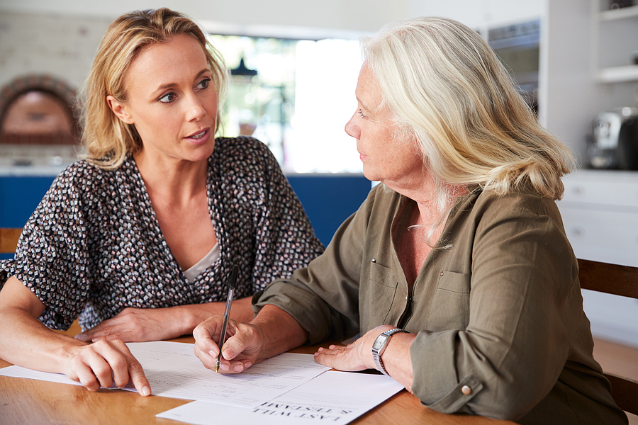 Woman helping an old lady plan her wills and estate in Campbelltown
