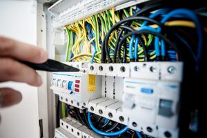 electrical wiring being checked by an electrician in Gold Coast